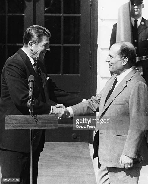 US President Ronald Reagan shaking hands with French President Francois Mitterand after a meeting in the Oval Office of the White House Washington D...