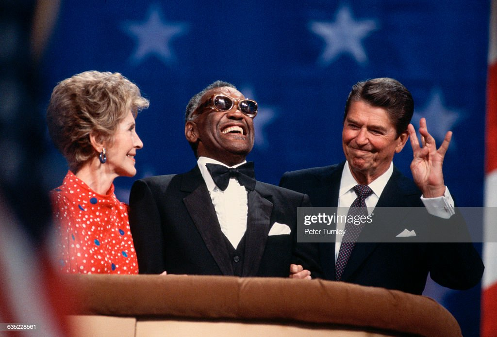 US President Ronald Reagan shares the podium at the Republican National Convention, where he is campaigning for a second term as President, with his wife Nancy and musician Ray Charles.
