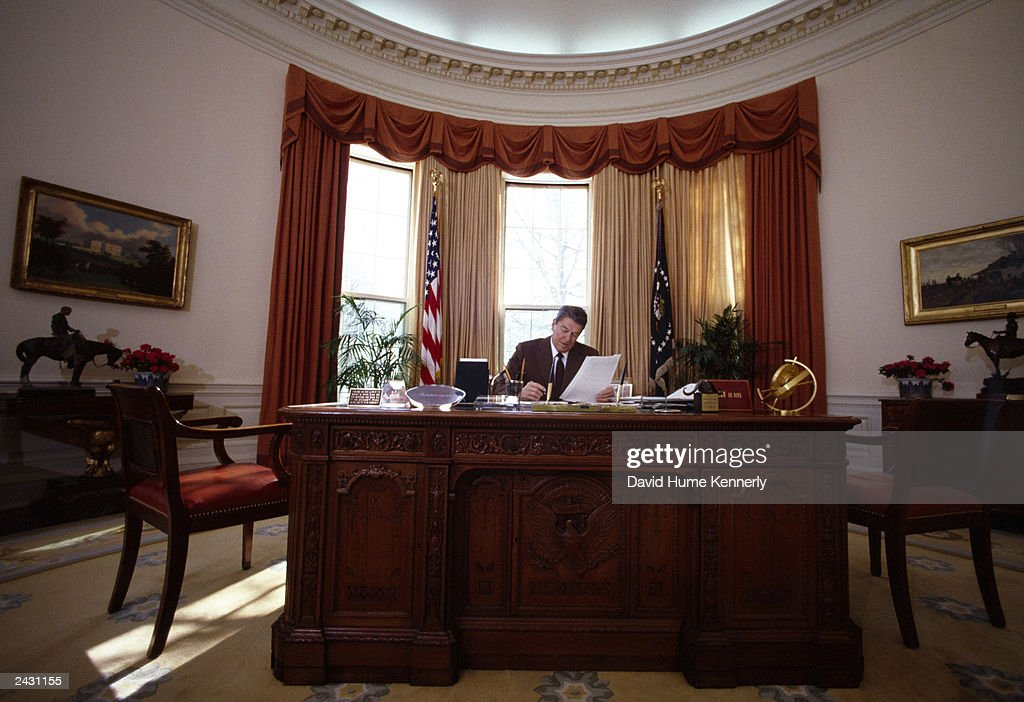 desk in oval office. U.S. President Ronald Reagan Sits At His Desk In The Oval Office White House