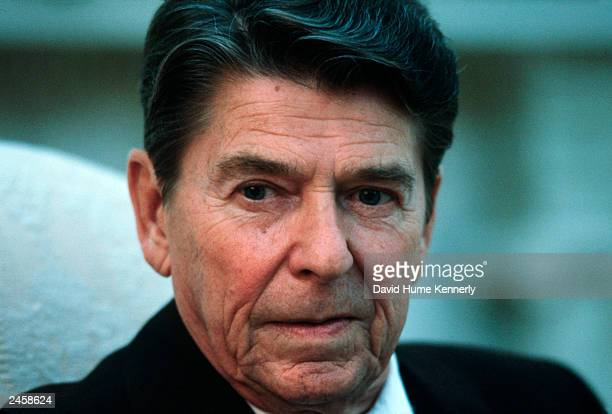 President Ronald Reagan sits in the Oval Office of the White House during a Time Magazine interview in 1983 Washington, DC.