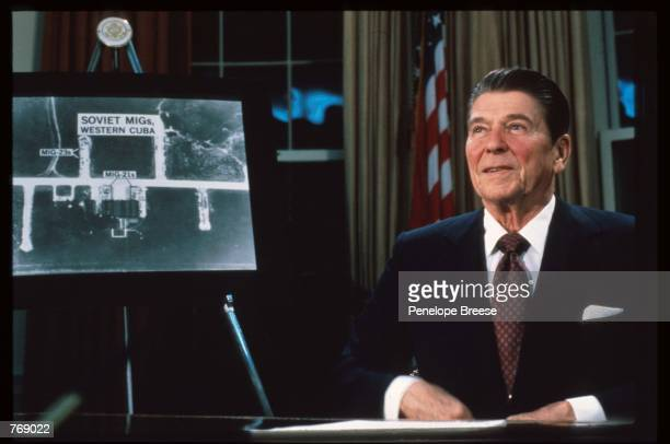 """President Ronald Reagan sits March 23, 1983 in Washington, DC. Reagan showed photos of Cuban missile sites and called Russia """"The Evil Empire"""" at a..."""