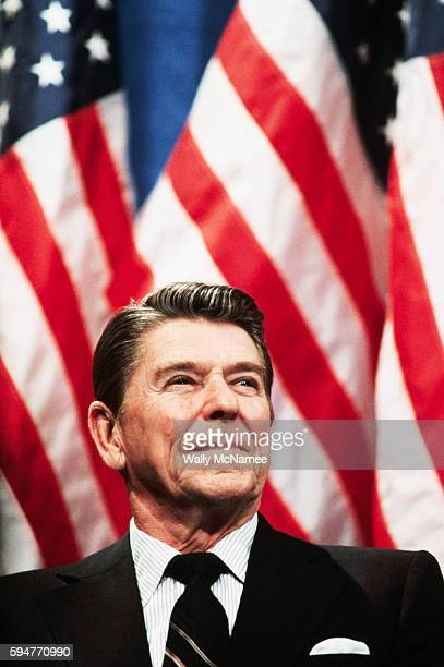 President Ronald Reagan sits on stage waiting to speak on behalf of US Senate candidate, and former astronaut, Harrison Schmitt in Albuquerque, New...