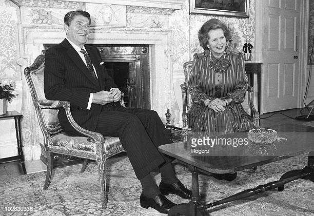 US President Ronald Reagan sits with British Prime Minister Margaret Thatcher at 10 Downing Street London on June 05 1984