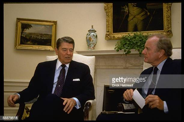 President Ronald Reagan sitting for interview with TIME magazine writer Hugh Sidey in the Oval Office of the White House