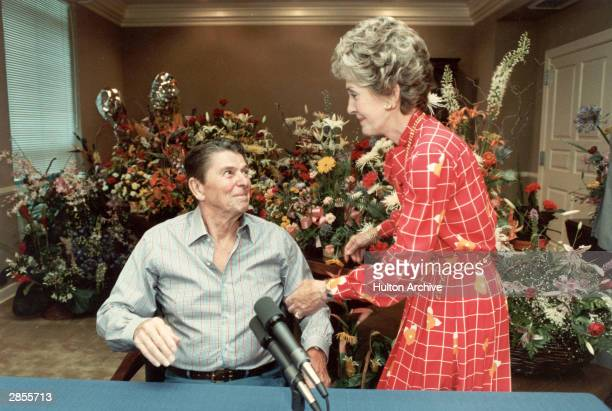 President Ronald Reagan smiles at First Lady Nancy Reagan after delivering his weekly radio address to the nation from Bethesda Naval Hospital...