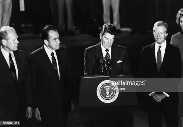 President Ronald Reagan speaking with three former US Presidents Gerald Ford Richard Nixon Reagan and Jimmy Carter as they eulogize Egyptian...