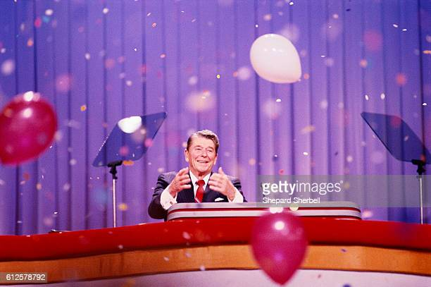 President Ronald Reagan standing at podium as balloons and confetti fall. He is at the 1988 Republican National Convention.