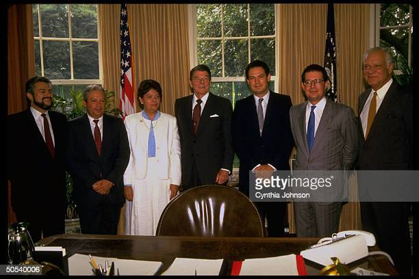 President Ronald Reagan standing with Nicaraguan contra leaders Adolfo Calero Alfredo Cesar Pedro Joaquin Maria Azucena Aristides Sanchez and Alfonso...