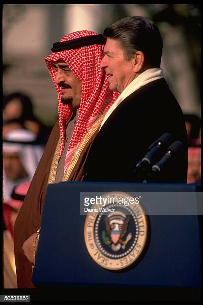 President Ronald Reagan standing with Saudi Arabian King Fahad at welcome ceremony on the South Lawn of the White House