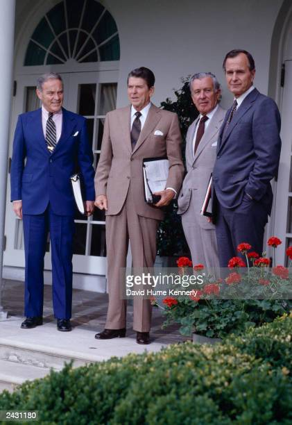 US President Ronald Reagan stands in the Rose Garden with Secretary of State Alexander Haig Donald Regan Secretary of Labor and Vice President George...