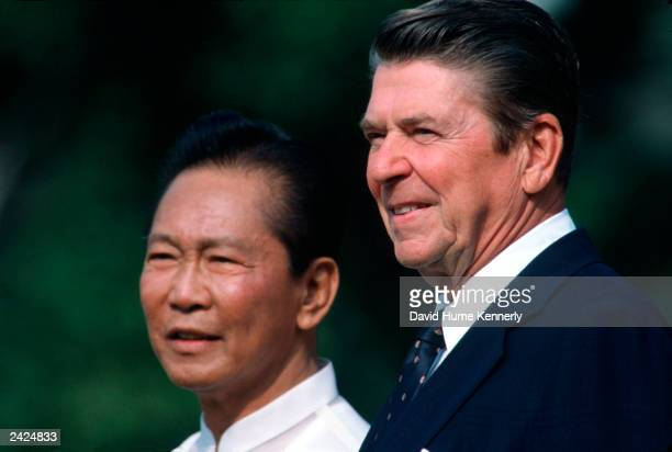 US President Ronald Reagan stands with President Ferdinand Marcos of the Phillipines on the South Lawn of the White House September 1982 in...