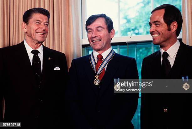 President Ronald Reagan stands with the first space shuttle astronauts John W Young and Robert L Crippen decorated at the White House after their...