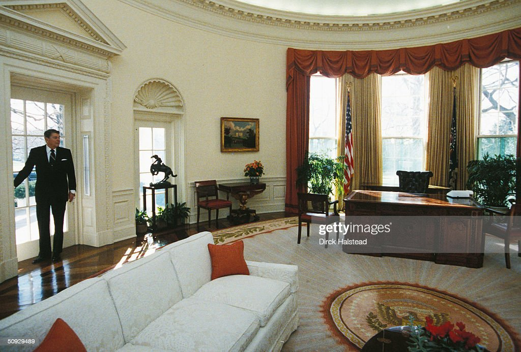 President Ronald Reagan takes one last fond look back at the Oval Office at the White House January 20, 1989 as he leaves for the Capitol for the inauguration of President George H.W. Bush.
