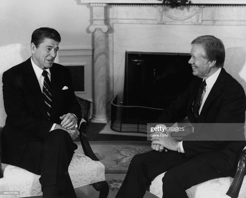 jimmy carter oval office. President Ronald Reagan (left) Talking To Former Jimmy Carter At A Meeting Regarding Oval Office V
