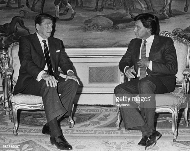 US President Ronald Reagan talking to Spanish Prime Minister Felipe Gonzalez on a twoday trip to Madrid May 1985