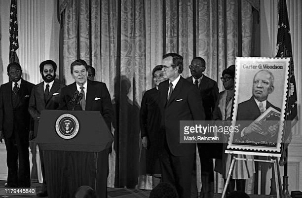 President Ronald Reagan unveils postage stamp of Carter Woodson at a White House Ceremony marking the observance of National AfroAmerican History...