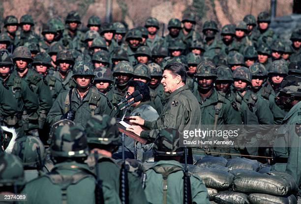 US President Ronald Reagan visits US troops at Camp Casey near the DMZ November 13 1982 near Tongduchon South Korea
