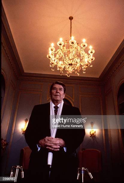 US President Ronald Reagan waits for Soviet leader Mikhail Gorbachev November 19 1985 in Geneva Switzerland The historic fireside chat between...