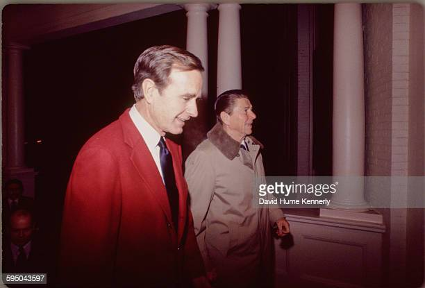 President Ronald Reagan walks with Vice President George HW Bush as the President arrive at the Vice President's residence on February 23 1981 in...