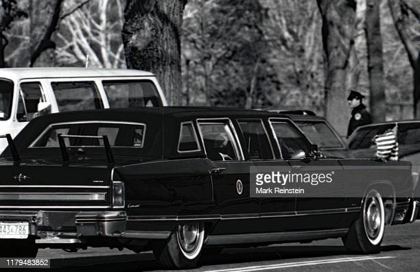 President Ronald Reagan waves from the back seat of his limousine on the way to the Russell Senate Office Building for the Republican congressional...