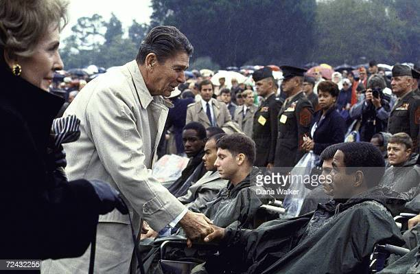 President Ronald Reagan wife Nancy during memorial service for soldiers killed in terrorist bombing of Beirut Marine HQ during US invasion of Grenada...