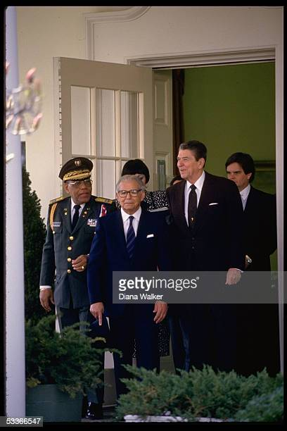 President Ronald Reagan with Dominican Republic President Joaquin Balaguer Ricardo with unidentified at WH
