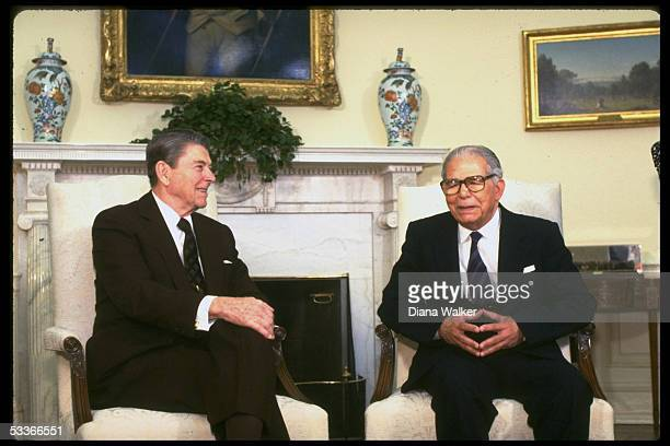 President Ronald Reagan with Dominican Republic President Joaquin Balaguer Ricardo in Oval Office at WH