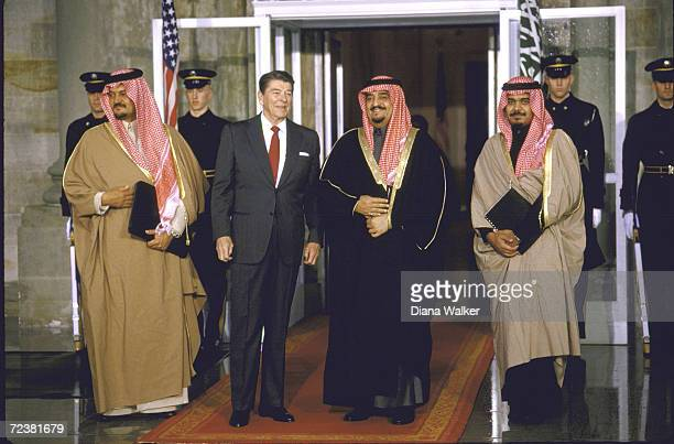 President Ronald Reagan with Saudi King Fahd Princes Bander Saud at WH portico