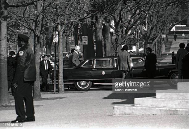 """President Ronald Reagan""""u2019s limousine turns onto Delaware Ave and stops in front of the Russell Senate Office Building, Reagan can be seen in the..."""