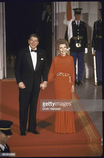US President Ronald W Reagan and his wife posing for a picture at the White House