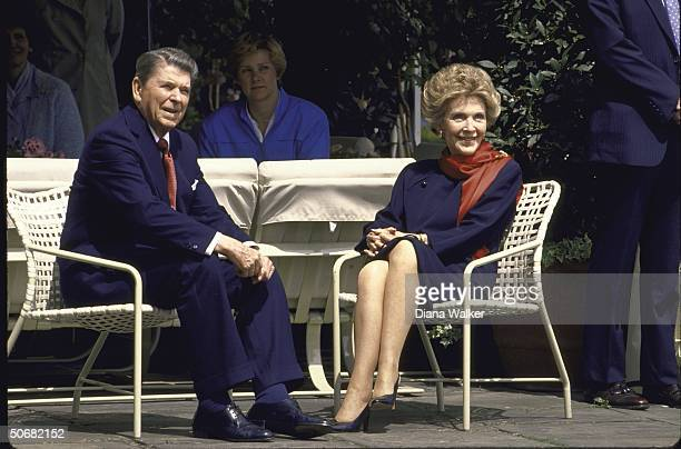 President Ronald W Reagan and wife Nancy sitting before their departure