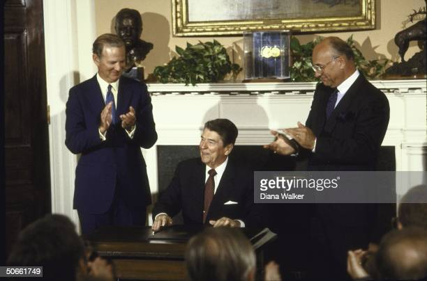 US President Ronald W Reagan signing the Canadian Free Trade Agreement letters of intent