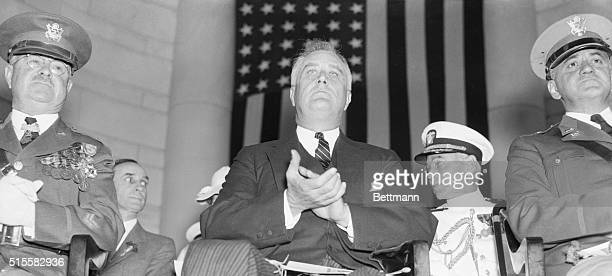 President Roosevelt applaudes during the annual memorial services in the amphitheater in Arlington National Cemetery