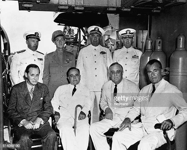 President Roosevelt meets with President Getulio Vargas of Brazil aboard a US Navy destroyer off the coast of the city of Natal Seated from left to...