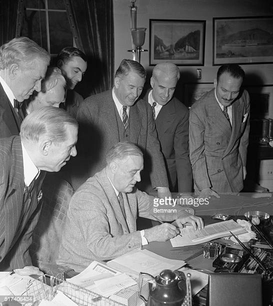President Roosevelt signed the renewal of the Lend Lease Bill yesterday thereby extending it for another year Watching the president as he affixed...