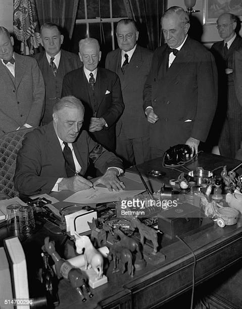 President Roosevelt signing document