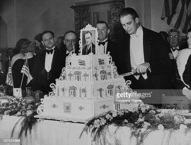 President Roosevelt Son Cutting The Huge Birthday Cake Of His Father At California Beverly Hills In Usa On January 30Th 1934