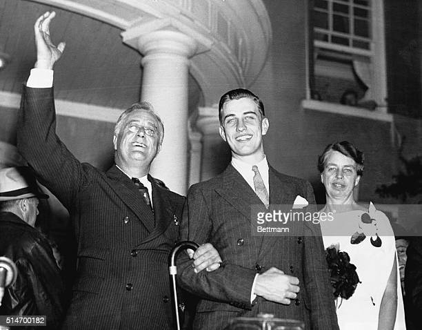 President Roosevelt waves from his Hyde Park home with his son Franklin Jr and First Lady Eleanor on the night of his reelection His neighbors have...