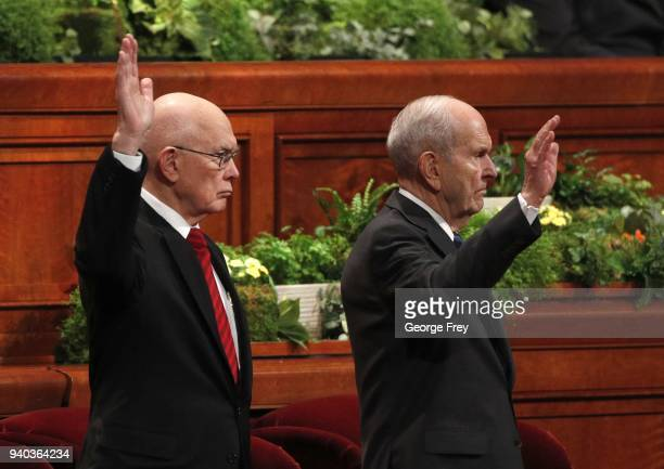 President Russell M Nelson and 1st Councilor Dallin H Oaks raise their hand to sustain themselves as leaders of the Mormon Church during the first...