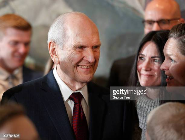 President Russell M Nelson of the Church of Jesus Christ of Latter Day Saints is greeted by family members after a press conference to announce...
