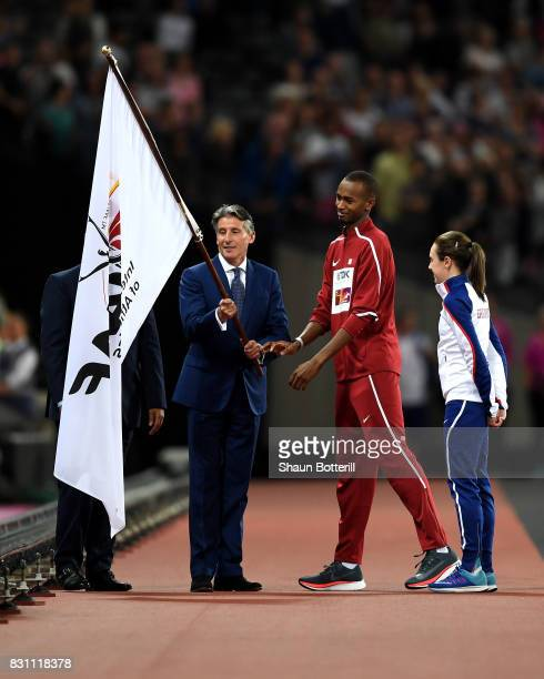 President Sebastian Coe , Mutaz Essa Barshim of Qatar and Laura Muir of Great Britain participate in the handover ceremony during day ten of the 16th...