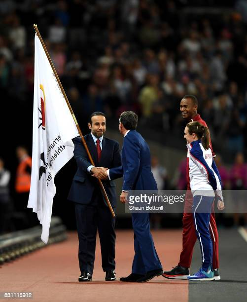 President Sebastian Coe, Mutaz Essa Barshim of Qatar and Laura Muir of Great Britain participate in the handover ceremony during day ten of the 16th...