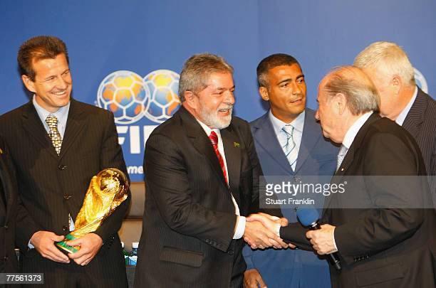 President Sepp Batter shakes hands with Brazilian President Luiz Inacio Lula da Silva whilst being watched by Brazilian National Football Coach Dunga...