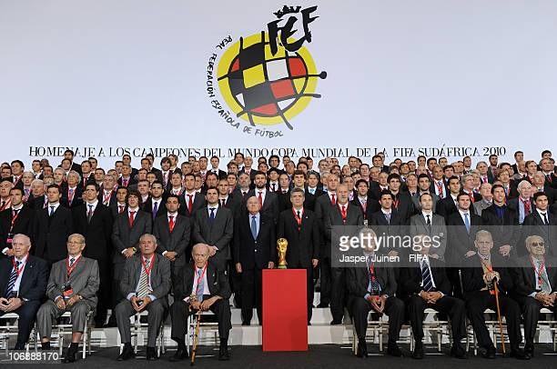 President Sepp Blatter and the President of the Spanish Football Federation Angel Maria Villar stand with current and former Spanish football players...