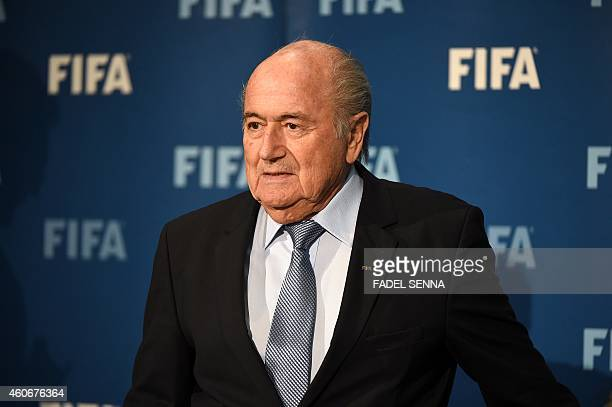FIFA president Sepp Blatter arrives for a press conference on December 19 2014 in the Moroccan city of Marrakesh top US lawyer Michael Garcia...