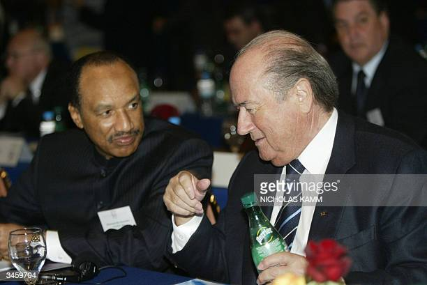 President Sepp Blatter chats with his counterpart from the Asian Football Confederation Mohamed bin Hammam before the start of the European ruling...