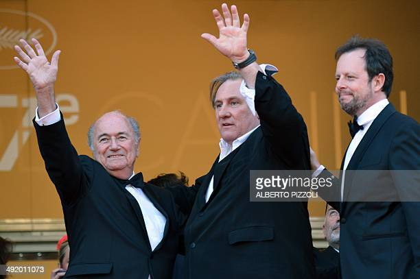 FIFA President Sepp Blatter French actor Gerard Depardieu and French director Frederic Auburtin pose as they arrive for the screening of the film...