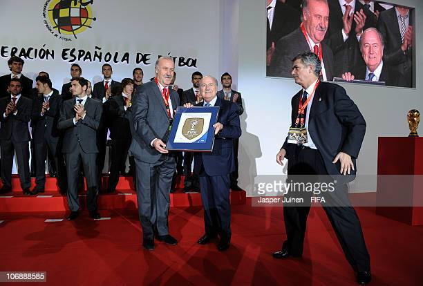 President Sepp Blatter hands over the FIFA World Champions Badge to Spanish Head coach Vicente del Bosque flanked by the President of the Spanish...