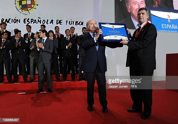 President Sepp Blatter hands the FIFA World Champions Badge to the President of the Spanish Football Federation Angel Maria Villar on November 15...