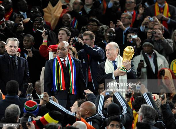 President Sepp Blatter holds the trophy after the 2010 FIFA World Cup Final between the Netherlands and Spain on July 11 2010 in Johannesburg South...